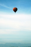 Balloon and mountains. Sky and mountains with balloon together royalty free stock photos