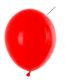 Balloon and needle. Red inflatable balloon with a needle Royalty Free Stock Photography