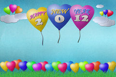 Balloon New Year 2012. Recycled paper craft on paper background Royalty Free Stock Photography