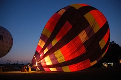 Balloon at Night. A hot air balloon being inflated at night Royalty Free Stock Photos