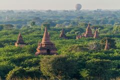 Balloon over Bagan - hot air balloons floating among the skyline of temples, Myanm