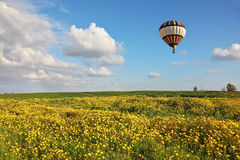 A balloon over the field Royalty Free Stock Photo