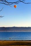 Balloon over lake royalty free stock image