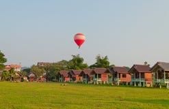 Balloon over the land. Vang Vieng. Laos. Stock Photography
