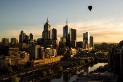 Balloon Over Melbourne. Hot air balloon over Melbourne CBD at sunrise Stock Photos