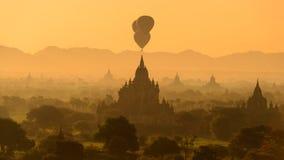 Balloon over plain of Bagan. Hot air balloon over plain of Bagan at sunrise, Myanmar royalty free stock image