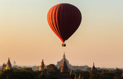 Balloon over plain of Bagan in misty morning, Myanmar Stock Image