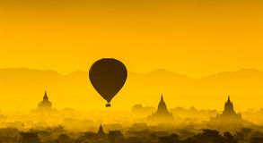 Balloon over plain of Bagan in misty morning, Myanmar Royalty Free Stock Image