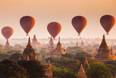 Balloon over plain of Bagan in misty morning, Myanmar. Hot air balloon over plain of Bagan in misty morning, Myanmar royalty free stock photos