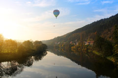 Balloon over river Royalty Free Stock Image