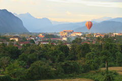 Balloon over Song river in Vangvieng. Vang Vieng is a tourist attraction town in northern Laos Royalty Free Stock Photos