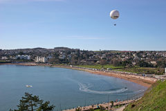 Balloon over Torbay. Balloon flying over Torquay beach Stock Images
