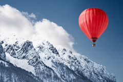 Balloon over winter landscape Stock Photos