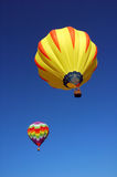 Balloon pair. A pair of hot air balloons in flight over Iowa during a balloon festival Stock Photo