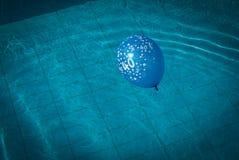 Balloon in pool Stock Photos