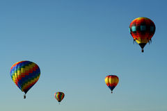 Balloon Quartet. Colorful hot air balloons soaring in a deep blue sky Royalty Free Stock Image