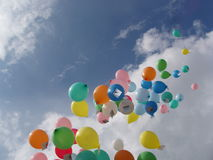 Balloon race. 2000 helium-filled balloons being released into the sky on a sunny day Stock Images