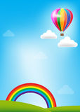 Balloon and rainbow on blue sky background Royalty Free Stock Photos