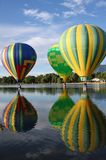 Balloon reflection. Three hot air balloons with reflection in water Royalty Free Stock Image