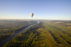 Balloon and river sunrise Royalty Free Stock Photo