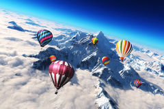Balloon's soaring. Colorful hot air balloon's soaring above a majestic snow caped mountain scape Stock Photography