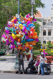Balloon salesman on the center of Saigon Vietnam . He usually sales balloon on weekend, holiday and Lunar new year Royalty Free Stock Photo
