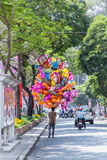 Balloon salesman on the center of Saigon Vietnam . He usually sales balloon on weekend, holiday and Lunar new year Royalty Free Stock Photography