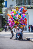 Balloon salesman on the center of Saigon Vietnam . He usually sales balloon on weekend, holiday and Lunar new year Royalty Free Stock Image