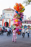 Balloon saleswoman in front of Ben Thanh market, Saigon ( Ho Chi Minh City ) , Vietnam . She usually sales on  holiday and Lunar n Stock Photo
