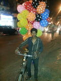 Balloon seller. A boy selling balloons in the streets of Mumbai Stock Image