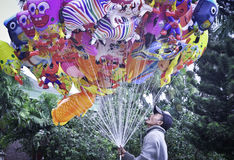 Traditional Balloon sellers. Ballon sellers with various kinds of balloons in puputan badung park, Bali - Indonesia Stock Photos