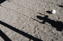 Balloon and shadow of a child on a swing Stock Photos
