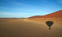 Balloon shadow over namib dunes Royalty Free Stock Photos