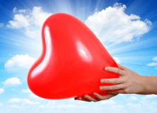 Balloon in the shape heart in hands Stock Photography