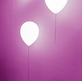 Balloon shape lamp on wall Stock Photo