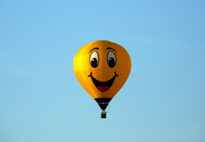 Balloon smile on blue background Royalty Free Stock Image