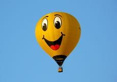 Balloon smile on blue background Royalty Free Stock Photo