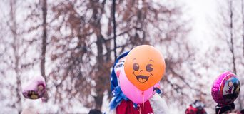 The balloon smiles emotions. Balloon smiling emotions at the festival, on the street Royalty Free Stock Photo