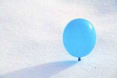 Balloon in the snow Royalty Free Stock Image