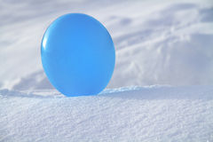 Balloon in the snow royalty free stock photography