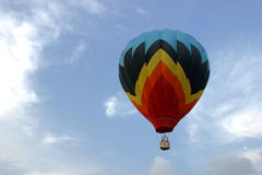 Balloon Soaring in the Sky. A multicolored hot air balloon soars in the sky stock photography