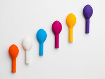 Balloon staircase. Colorful ballon arrangement from the left lower corner to the right upper corner on a white background Stock Images