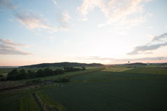 Balloon sunset. Balloon ride over the fields Stock Photography