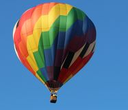 Balloon taking flight at festival Royalty Free Stock Image