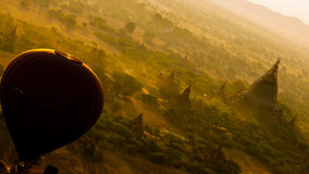 Balloon and a temple. A balloon flying over the breathtaking scenery in Bagan Myanmar Royalty Free Stock Photos