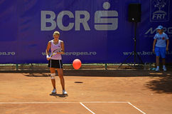 Balloon on tennis court Royalty Free Stock Photo