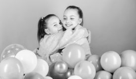 Balloon theme party. Girls best friends near air balloons. Birthday party. Happiness and cheerful moments. Carefree. Childhood. Start this party. Sisters stock images