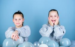 Balloon theme party. Girls friends near air balloons. Start party. Birthday party. International childrens day. Carefree. Childhood. Sisters organize home party stock images