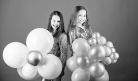 Balloon theme party. Girls little siblings near air balloons. Birthday party. Happiness and cheerful moments. Carefree. Childhood. Start this party. Sisters stock photos