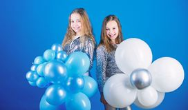 Balloon theme party. Girls little siblings near air balloons. Birthday party. Happiness and cheerful moments. Carefree. Childhood. Start this party. Sisters stock image